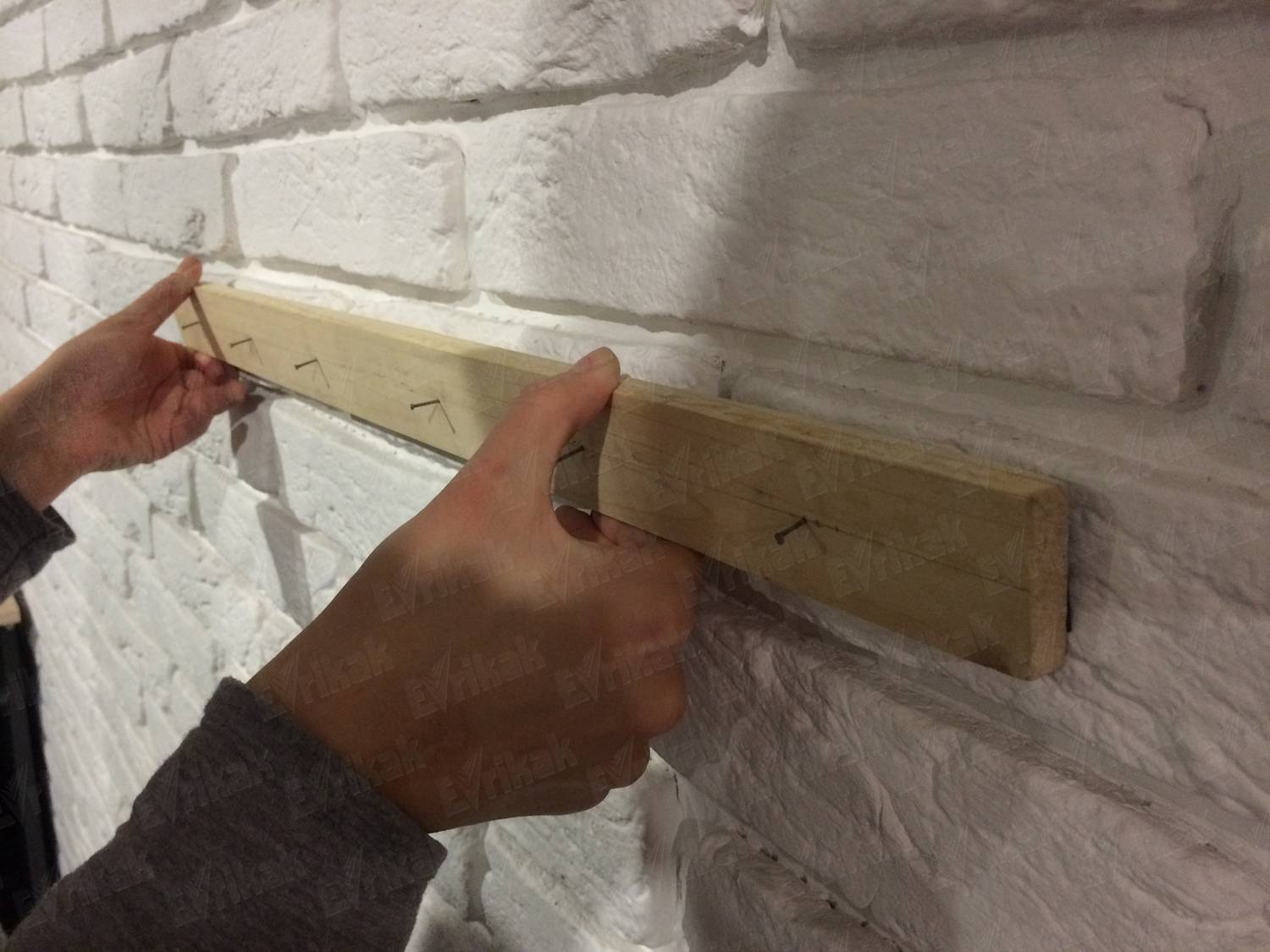 Nailing the lower wooden plank